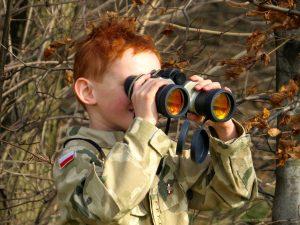 person using binoculars